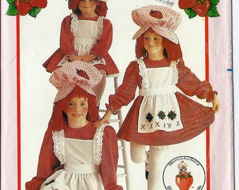 Girl's Strawberry Shortcake costume pattern including dress, apron, bloomers and hat in sizes 7, 10 Butterick 6139 UNCUT & FF (1980s)  K0957