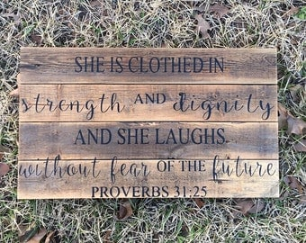 She is clothed in strength and dignity and she laughs without fear of the future proverbs 31:25 bible verse quote sign wood inspirational