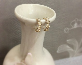 14 karat plumerias hoop earrings