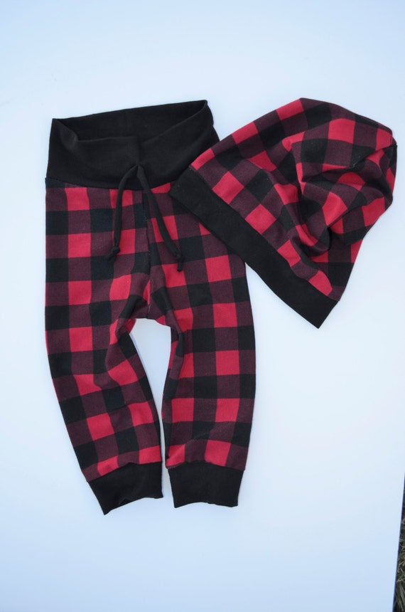 Plaid patterns in suits are usually very small print, and made in subtle neutrals like black, grey and navy. For casual warm weather outfits, capri pants in plaid are a fun and playful centerpiece. A pair of blush pink and spring green plaid capri pants and a white T-shirt make an adorable outfit for any little girl.