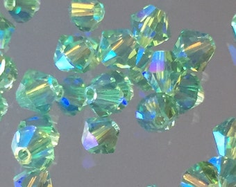Swarovski Crystals Green 4mm Faceted Bicones - Peridot AB2X (Light Green/Blue)- Package of 24