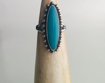 Sterling Silver Maisels Southwestern Style Elongated Marquise Shaped Turquoise Coloured Stone Ring with Pebbled Edges
