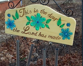 """Wind chimes wood burned sign with scripture """"This is the day that the Lord has made"""" painted and embellished"""