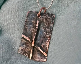 Fold formed upcycled textured rectangle copper pendant necklace