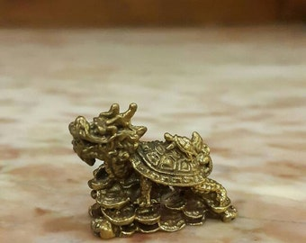 Brass miniature of Chinese Dragon as a lucky turtle on top of piles of gold. Lucky symbol bring good fortune, wealth, happiness. Home decor