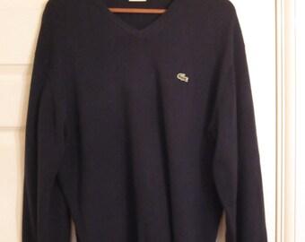 Lacoste dark blue v neck jumper. Size 5