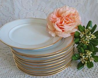 10 very elegant porcelain dessert plates, 30s. France.