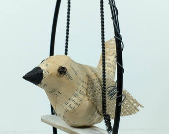 Bird on swing, junk art, sculpture, recycled materials, repurposed materials, paper mache bird, burlap wings, wire flower, whimsical