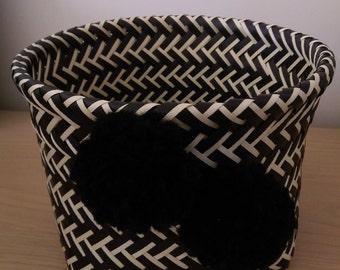Black and cream ticker tape basket with black woollen pom poms