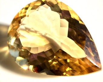 One Natural Yellow 10.44 carat Citrine in a Pear Shape of Fine Open Color w/ IAS Jewelry Appraisal WAS 460 NOW 348!