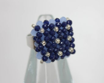 Maxi ring of semiprecious stones and crystals in shades of blue.
