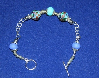 Bracelet made with lampwork beads in blues and turquoise