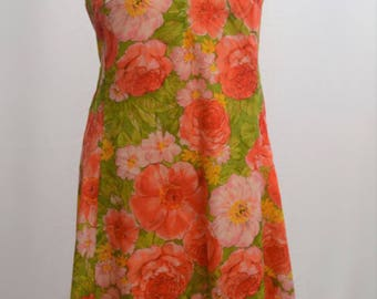 1960s/70s floral shift dress in bold orange and greens. UK size Large
