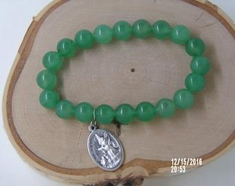 B1253 Small Jade Glass Beaded Bracelet with religious metal Charm.