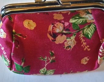 small wallet flowers on pink background