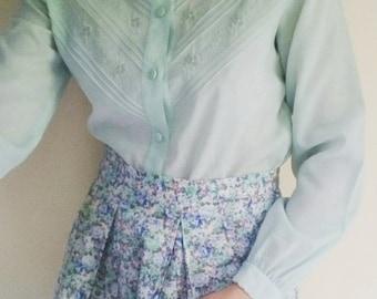Feminine vintage powder blue embroidered blouse size 6