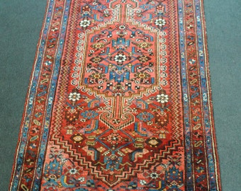 Handmade Persian rug made hands Persian from the 1970s. size 202x108cm.