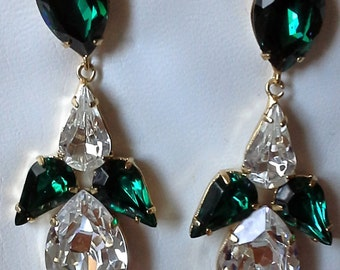 Vintage long earrings, made with green and white Swarovki crystal and 18k gold plated. Unused