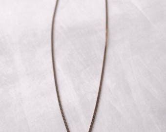 Oxidized sterling silver necklace with oxidized engraved pendant