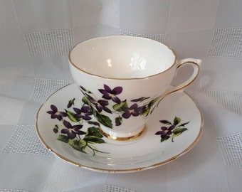 "Set Cup and saucer made in white, Purple Violets, gilding. ""Delphine Bone China, Made in England"" c.1930."