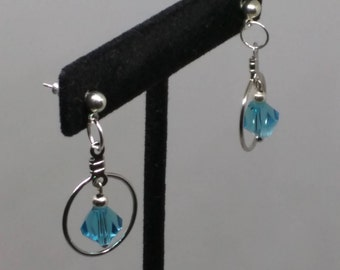 Light blue bead framed in silver hoop earrings.  1 1/4 inches long. FREE SHIPPING