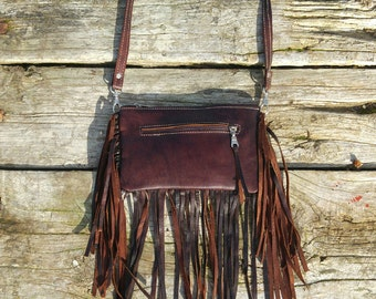 Bag of fringe ethnic style. 100% natural skin