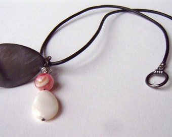 Mother-of-pearl two-pendant necklace on a leather strap