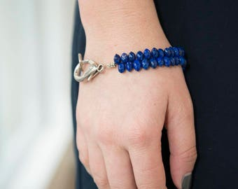 Blue sapphire bracelet with large silver clasp