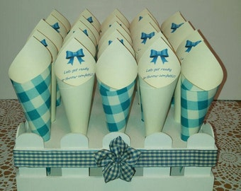 25 Confetti cones displayed in a white picket fence crate