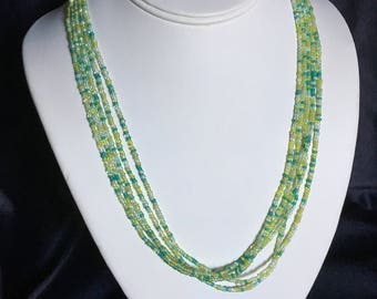 Green and turquoise five-strand necklace with matching bracelet.