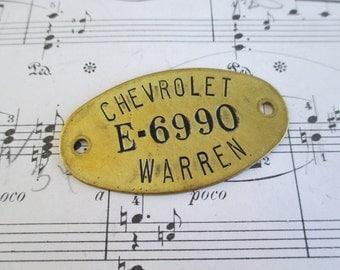 Vintage Brass Numbered Chevrolet Tag Warren Michigan (E)