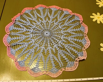 Large Round Blue Crocheted Doily With Pink Border