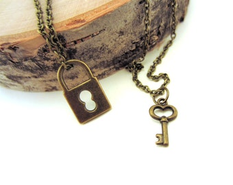 Lock and key necklace. Best friend gift. Gold charm necklaces. Tiny key, lock charms. Best friend necklace. Bronze necklaces.