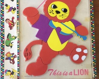 vintage puzzles - Take it Out and Put it Back Together Again plastic puzzles - No. 204 Lion & No. 202 Dog