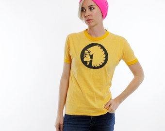 Vintage 70's Mutual Of Omaha logo t-shirt, ringer style with yellow cuffs and collar, body of shirt is a heather yellow, no text -Small