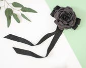 Grey flower brooch with a black bow made from ribbon, bow tie brooch with flower