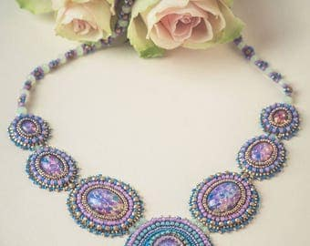 Aurora handmade necklace with dicroic glass cabochon and swarovski crystals.