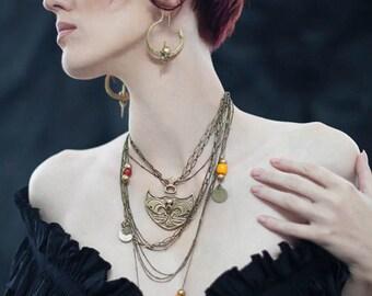 Miyu Decay Gauged Crescent Bat Hooped Earrings in Brass