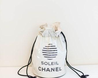 CHANEL white vinyl drawstring bucket tote bag backpack