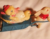 Antique Easter Bunny toy egg moving wagon with duck and chick and egg
