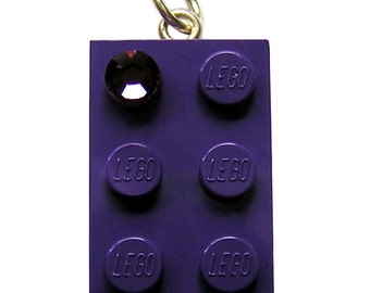 Purple LEGO (R) brick 2x4 with a Purple SWAROVSKI crystal on a Silver/Gold plated trace chain or on a Purple ballchain