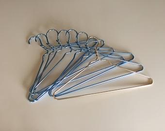Seven Vintage 50s Aluminum Clothing Hangers