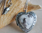 White turquoise heart music box locket, heart shaped locket with music box inside, in silver tone.