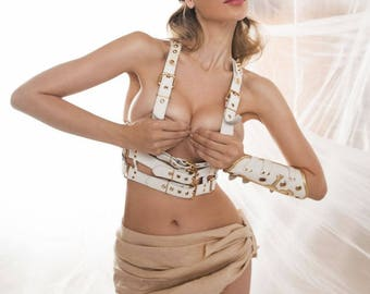 Golden cage woman white leather harness