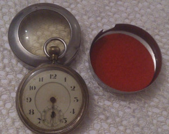 antique pocket watch in a case
