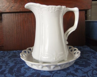 White Porcelain Creamer and Lacy White Porcelain Saucer