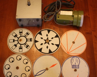 Vintage Rare Magician's motorized optical illusions with (6) different optical disc.- Bird in a Cage , Light the bulb, motor, etc