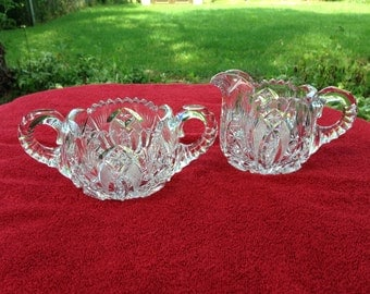 Cut crystal elegant sugar bowl and creamer handles intricate starburst design