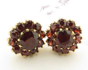 "Vintage 14 kt Gold Red Garnet (4 cts, tw) Cluster Clip Back .5"" Circular Earrings."
