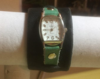 vintage watch face with handmade leather wrist band